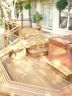 Gorgeous deck with built-in seating and a unique railing design.  A lot like our Newport News, VA home.