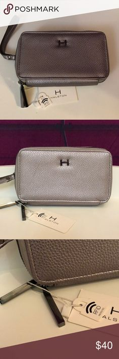 Halston Hillary double zip wallet silver pebbled Beautiful silver pebbled metallic Halston wristlet!  HW0002 Hillary Double zip wallet (with wrist carry)  Brand new with tag in retail and ready to ship!  Beautiful gunmetal shiny hardware!  7 1/2 inches long by 5 inches in height by 1.75 inches in depth… Expandable with the double zip option. See picture of how it unfolds. The strap is 6 inches long.  Has 4 card slots, 5 compartments , 1 zip inner compartment, plenty of room!! Opens up at 9…
