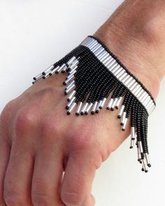 Silver and Black V Fringe Loom Woven Bracelet by ninaclairedesigns Bead Loom Bracelets, Woven Bracelets, Jewelry Bracelets, Bead Loom Patterns, Bracelet Patterns, Beading Patterns, Bold Necklace, Beaded Choker Necklace, Beaded Jewelry Designs