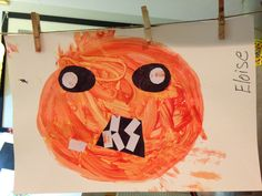 Fun fall toddler art projects! Jack-O-Lantern color mixing lesson with red, yellow and white paint.