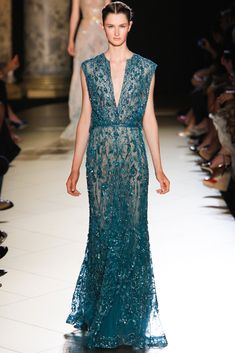 Elie Saab Fall 2012 Couture - Collection - Gallery - Style.com  Lovely, suggestive,  however doesn't detract from it's beauty.