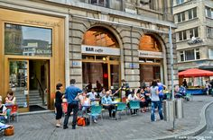 This Italian-style café in the proximity of the marketplace, with its small but nice terrace, is a great spot to observe local people go by drinking their Coffee Shops, Italian Style, Barista, Restaurant, Places, Image, Swiss Guard, Amazing, Diner Restaurant