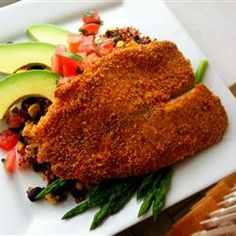 "Baked Parmesan Tilapia | ""Ranch dressing adds a zippy flavor to this crispy baked fish dinner."""
