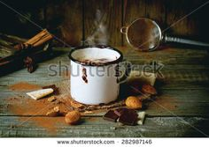 Vintage mug with hot chocolate served with chunks of white and dark chocolate and almonds on old wooden table - stock photo Wooden Tables, Moscow Mule Mugs, Hot Chocolate, Drinking, Royalty Free Stock Photos, Rustic, Almonds, Tableware, Pictures