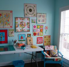 wall of mini quilts. I love the 3D flower quilt