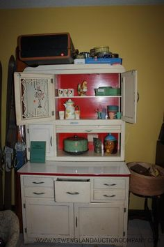 Hoosier Cabinet.  My Granny used to have one like this in her kitchen.  Its out in my parents shed right now and would totally be in me in my house if I had the room for it.