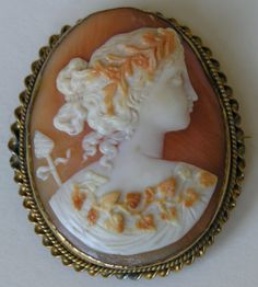"""Victorian Carved """"Bacchante"""" Shell Cameo Brooch/Pendant Showing Layers Of The Shell And Set In A Low Karat Gold Frame"""
