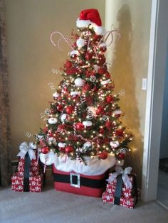 Santa Christmas Tree - Look at that base! - plus 31 Inspiring Christmas Tree Ideas on Frugal Coupon Living. Christmas Home Themes. Diy Christmas Decorations, Christmas Tree Themes, Santa Christmas, Winter Christmas, Christmas Home, Holiday Crafts, Christmas Ornaments, Candy Cane Christmas Tree, Christmas Tree On Table
