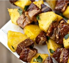 """Steak and Pineapple Skewers-Ingredients      ⅓ cups Low Sodium Soy Sauce      ⅓ cups Plus 1 Tablespoon Olive Oil, Divided      1 whole Garlic Clove, Grated Or Minced      Fresh Ground Pepper      2 whole Ribeye Steaks (about 10-12 Oz. Each And 1"""" Thick)      1 whole Pineapple      ½ cups Fresh Basil, Torn Into Small Pieces"""