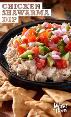 Dip into the deliciousness during this year's Big Game with refreshing Chicken Shawarma Dip. Grill seasoned, skinless chicken breasts (or tenders) to your liking and let them cool. Chop each chicken breast up and add to a mixture of Greek yogurt, tahini, lemon juice, garlic, cumin and salt. Refrigerate for an hour and top with chopped tomatoes, cucumbers and onions. Break out the WHEAT THINS Toasted Pitas and taste victory.