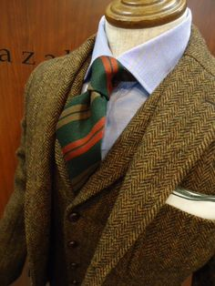 Great autumn look: Harris tweed jacket and vest paired with classic regimental tie in hunter green, terracotta, and olive.