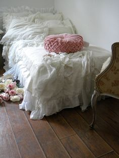 love this pillow and the old shabby chair