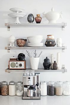 Black & white decor inspiration for the kitchen. Great collection of chic pottery that's anything but plain! #decorating ideas