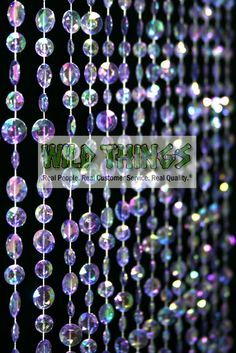 This awesome beaded curtain features large faceted beads. This purple IRIDESCENT color HAS the sparkly pearly top-coat on the beads. So the beads sparkle and reflect other colors. Our beads are ACRYLIC
