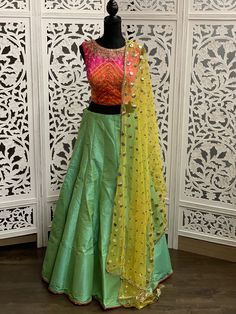 Elegant and classy dual tone of pink and orange choli with mint green lehenga paired with yellow choli is is surely a stunner. Sleeves Designs For Dresses, Sleeve Designs, Blouse Designs, Designer Bridal Lehenga, Bridal Lehenga Choli, Saree, Green Lehenga, Latest Colour, Lehenga Designs