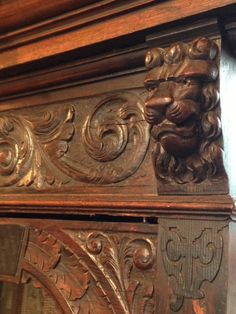 Detail of carving on glass door cabinet.