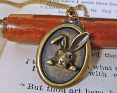 Tiny Bunny Love Necklace brass simple and small. $17.00, via Etsy.