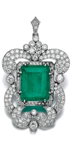 Emerald and diamond pendant Set with a step-cut emerald, within a frame composed of scroll motifs millegrain-set with circular- and single-cut diamonds.