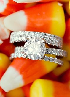 Halloween wedding picture ideas - candy corn and rings