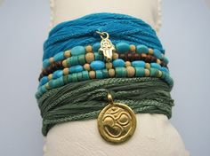 "I'm on the hunt for unique wrap bracelets .. Roughly 2.5-3"" wide, & that can tighten around wrist. Love these colors."