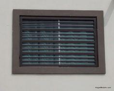 imagen de reja de ventana con barrotes horizontales