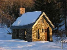 Stone Cabin - A simple, 10 x 15 foot timber frame with a slate roof, based on Thoreau's Walden cabin.