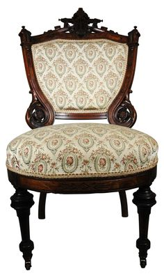 An antique Eastlake accent chair, that has been recently reupholstered in a sturdy patterned fabric with trim
