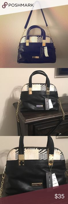 Olivia + Joy NWT Handbag Black Olivia + Joy handbag with a woven plaid design across the top. Great size, New with tags, really cute bag to dress up or keep casual Olivia + Joy Bags Shoulder Bags