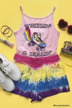 "A knit bodysuit featuring a front roller skate graphic and ""Wheelin & Dreamin"" text on the front, a scoop neck and back, cami straps, and a dual snap-button closure."