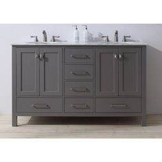 An ideal complement to a contemporary decor, the 60 inch Malibu Double Sink Vanity embodies the clean edges and sophistication of modern design. The rich grey cabinet, made of solid oak lends a warm f...