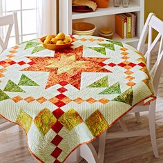 This bright quilt, perfect as a table topper or wall hanging, features a blazing star of fiery red, yellows, and orange batiks. The star shines against a pale green background. Designed by Kimberly Einmo and it's a free pattern from All People Quilt Star Quilts, Mini Quilts, Quilt Blocks, Star Blocks, Sampler Quilts, Quilted Table Toppers, Quilted Table Runners, Plus Forte Table Matelassés, All People Quilt