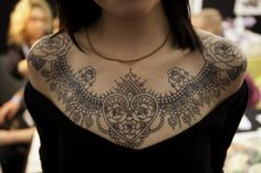 Lace chestpiece tattoo with roses on shoulders. Beautiful work.