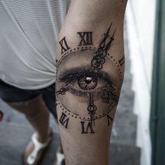 Perfect black and grey tattoo art of Clock with Eye motive done by Niki Norberg from Göteborg, Sweden