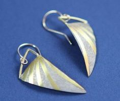 silver and gold keum-boo earrings by Joe Korth