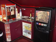 Home theater concession stand idea. Needs to be much more updated, along with the drink machine.