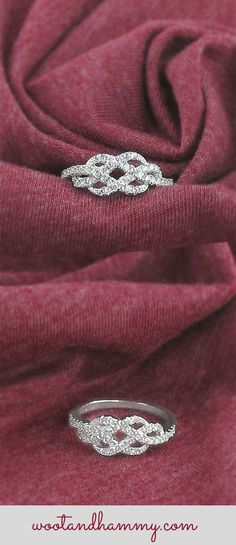 gorgeous fancy infinity ring encrusted with brilliant crystals in sterling silver.