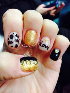 Nails by Juliet .. Gold sparkles nude and black heart studs