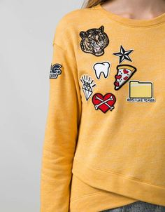 Modern cooked yellow sweater spruced up with iron-on patches. Teeth falling out from the pizza and the bear blinded by a diamond. **bling bling**