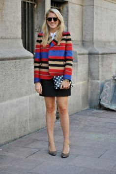 26 Street-Style Lessons In French Dressing - We love how Moda Operandi's Hayley Bloomingdale wore her striped jacket with a polka-dotted clutch — a mixed print that's easy to do, and lovely to see.
