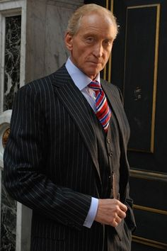 His Excellency President Hugh O'Neill Sr. (lbr he's a dictator, but like, a good dictator) Dapper Gentleman, Gentleman Style, Sharp Dressed Man, Well Dressed, Charles Dance, Game Of Throne Actors, Evolution Of Fashion, Pinstripe Suit, Vampire