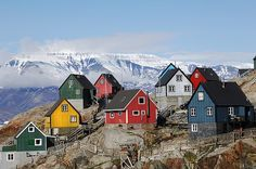 Part of Greenland with colourful wooden houses and icebergs