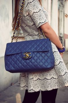 Blue Chanel Bag with a gorgeous patterned dress that has a cute lacy feel that makes a big impact