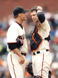 Game 24/162, 5/3/2012; Giants starting pitcher Ryan Vogelsong talks to his catcher, Buster Posey, during the first inning of the game against the Marlins.  The Marlins would go on to win the game 3-2.