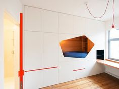 VAN STAEYEN Interior Architects, converted two bedrooms with a bathroom in between into a modern sleeping area.