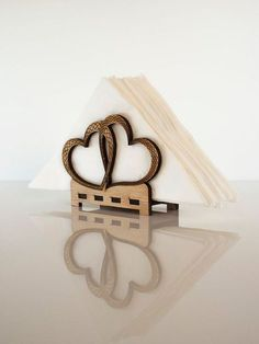 Add a great centerpiece to your kitchen or dining room table with this unique decorative napkin holder. Laser cut and engraved oak plywood.