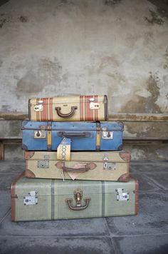"""We're kind of obsessed with good looking vintage luggage. In fact, we don't think that (in our adult life) we've ever purchased new luggage, always vintage. We especially like that if we're not using them for traveling we can use them as home decor (hello, side table!)."""