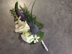 A Thistle and Lisianthus corsage for a lady that wants a touch of Scottish.