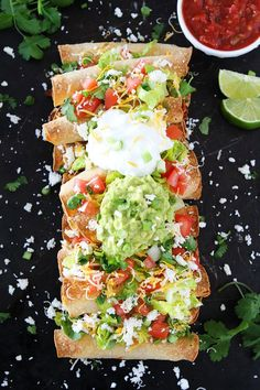 These easy oven Baked Chicken Taquitos are stuffed with chicken and cheese and make a great appetizer or meal. They can be made in advance and are perfect for parties! Serve with guacamole, sour cream, and salsa.
