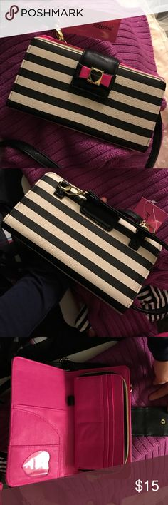 Cross body wallet A black and white stripe interior, pink on the inside. Has a lot of credit card slots, a built in coin purse. Never used, like new, tag still on. Betsey Johnson Bags Crossbody Bags