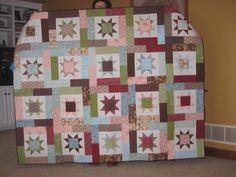 Prettiest one I've done, for Mom. Pink, blue and chocolate colors...The pattern is Lucky Stars, by Atkinson Designs. Took 20 fabrics. Looks complicated but is pretty easy.